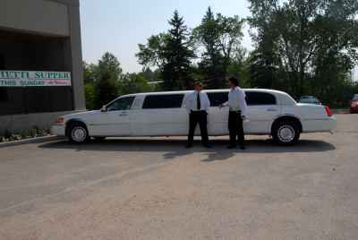Elvis standing with Stars Luxury Limousine Service